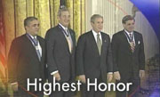 "George Tenet, Tommy Franks, President George Bush, Paul ""Jerry"" Bremer"